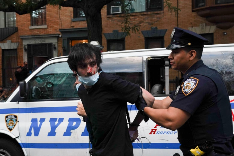 NYPD officers arrest protesters during a demonstration against the killing of George Floyd by Minneapolis police on May 30, 2020 in the Borough of Brooklyn in New York.