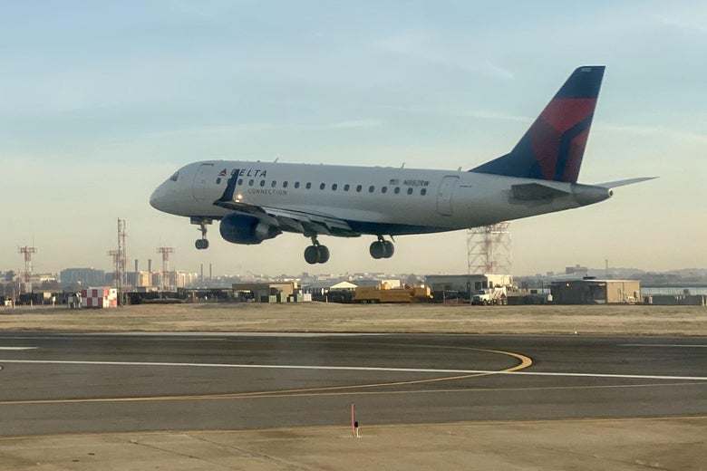 A Delta airplane lands at an airport.