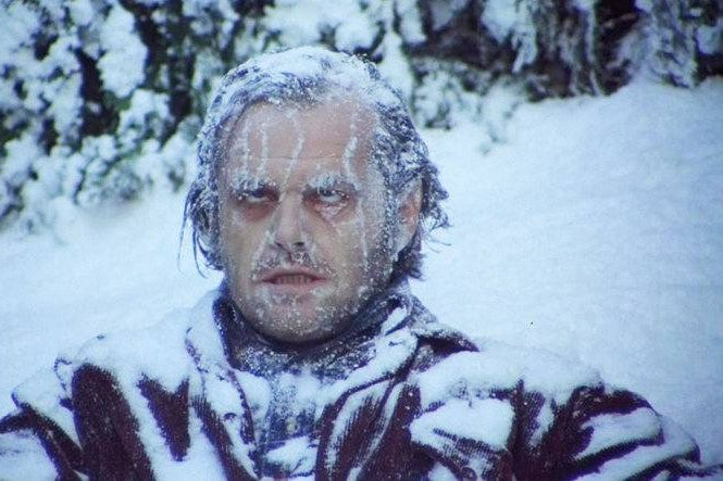 Jack Nicholson as Jack Torrance in The Shining, sitting in a hedge maze frozen to death, with snow and ice covering his face and clothes