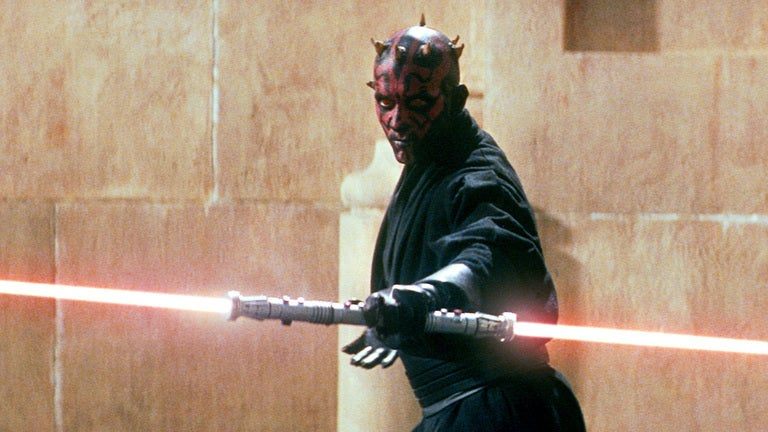 Ray Park as Darth Maul, with a double-bladed red lightsaber