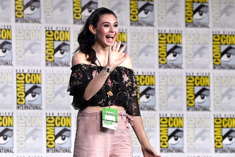 Activist Nicole Maines, smiling and waving at fans.