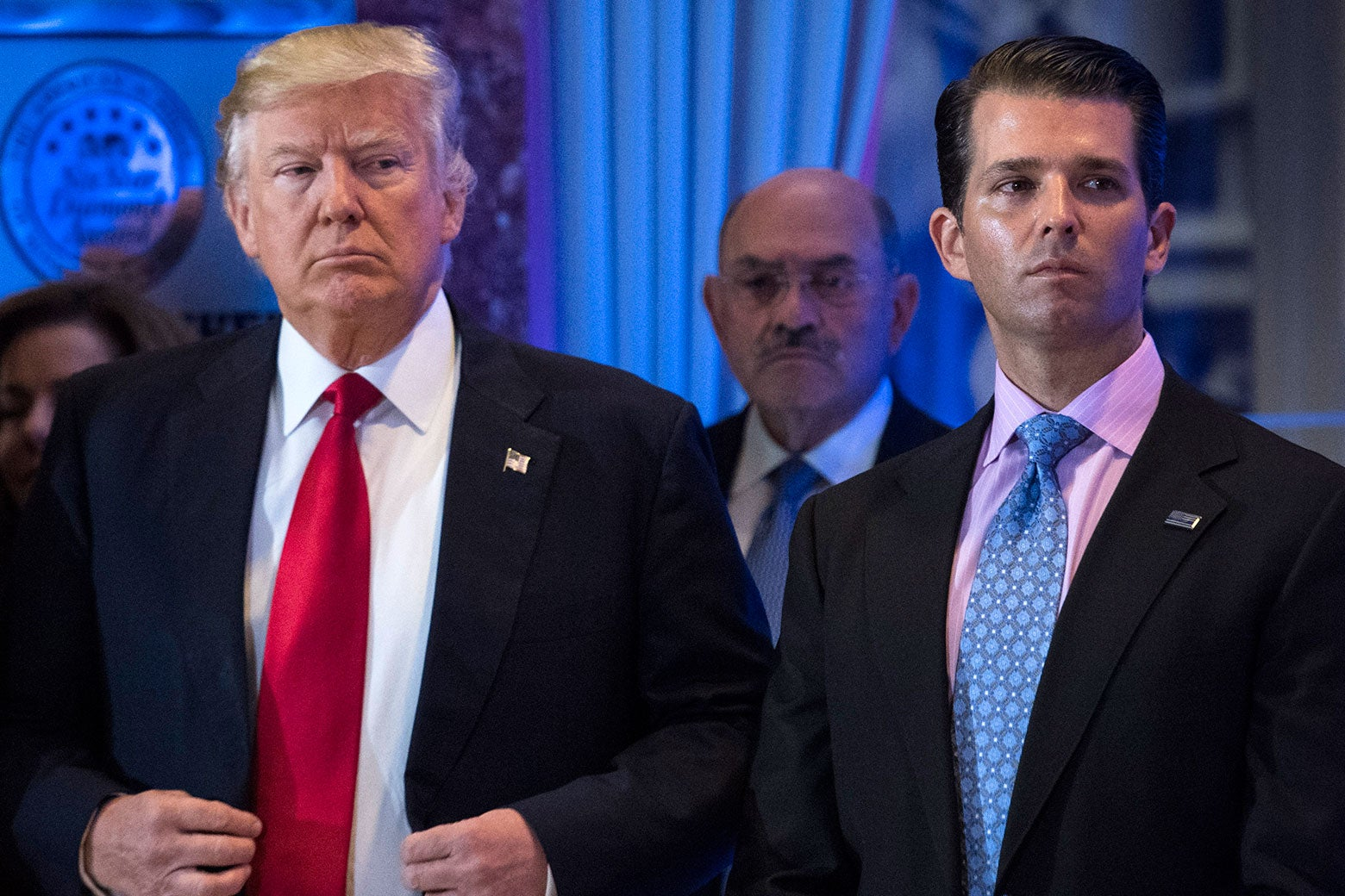 Donald Trump and Donald Trump Jr. stand beside each other.