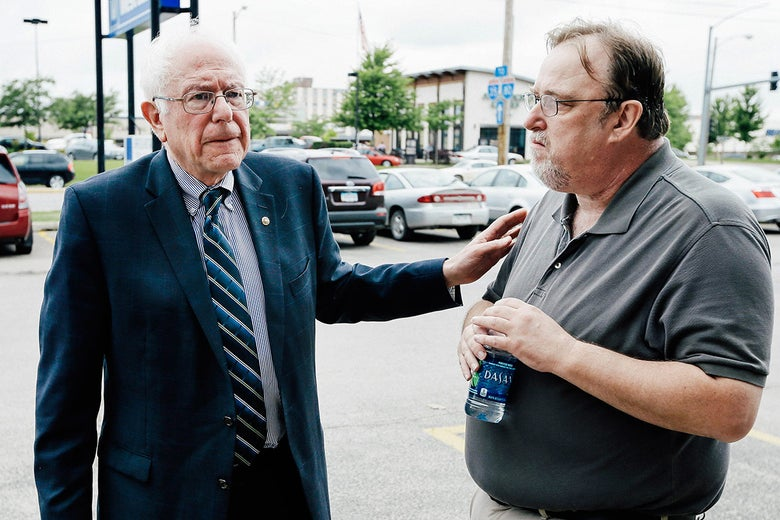 Bernie Sanders talks with his Iowa campaign coordinator Pete D'Alessandro, right, before speaking to supporters at an open house at his Iowa campaign headquarters, Saturday, June 13, 2015, in Des Moines, Iowa. (AP Photo/Charlie Neibergall)