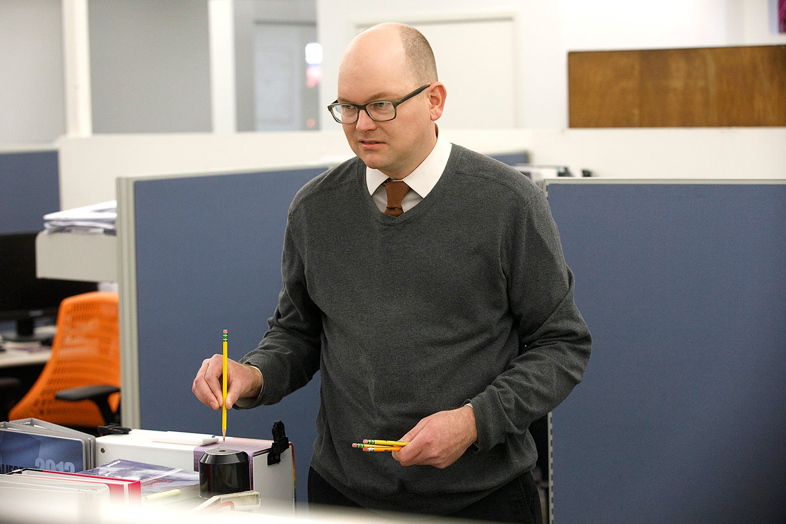 Mark Proksch as Colin Robinson, who is about to sharpen a pencil in this still from What We Do in the Shadows.