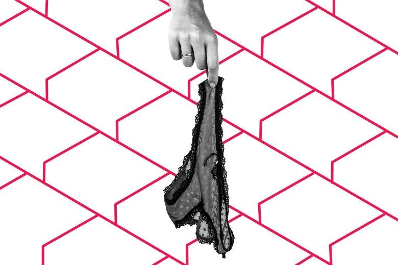 A hand dangling a pair of lacy underwear, with a patterned background