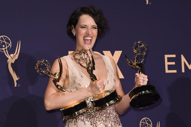 "British actress Phoebe Waller-Bridge poses with the Emmy for Outstanding Writing for a Comedy Series, Outstanding Lead Actress In A Comedy Series and Outstanding Comedy Series for ""Fleabag"" during the 71st Emmy Awards at the Microsoft Theatre in Los Angeles on September 22, 2019. (Photo by Robyn Beck / AFP)        (Photo credit should read ROBYN BECK/AFP/Getty Images)"