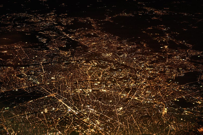 An aerial view of a city's lights at night