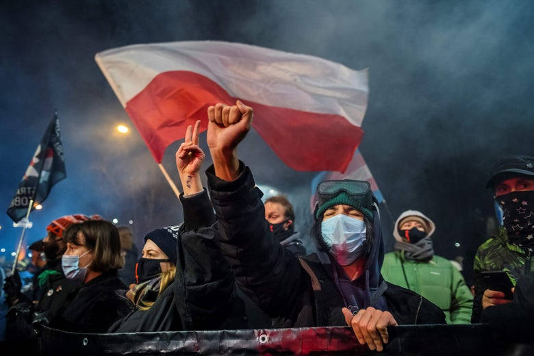 Pro-choice demonstrators wave flags as part of a nationwide wave of protests against Poland's near-total ban on abortion.