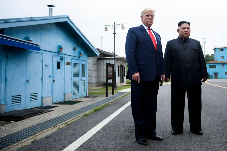 President Donald Trump and North Korea's leader Kim Jong Un talk before a meeting in the Demilitarized Zone (DMZ) on June 30, 2019, in Panmunjom, Korea.