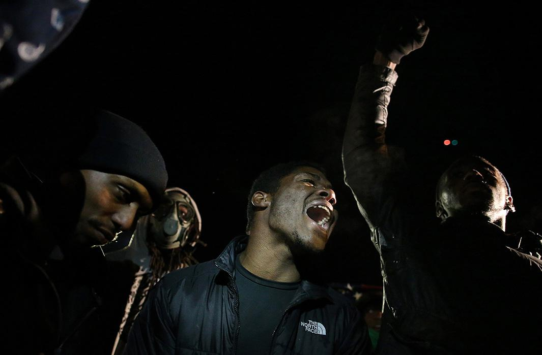 Protesters demonstrate in front of the Ferguson, Missouri, police station on Nov. 25, 2014
