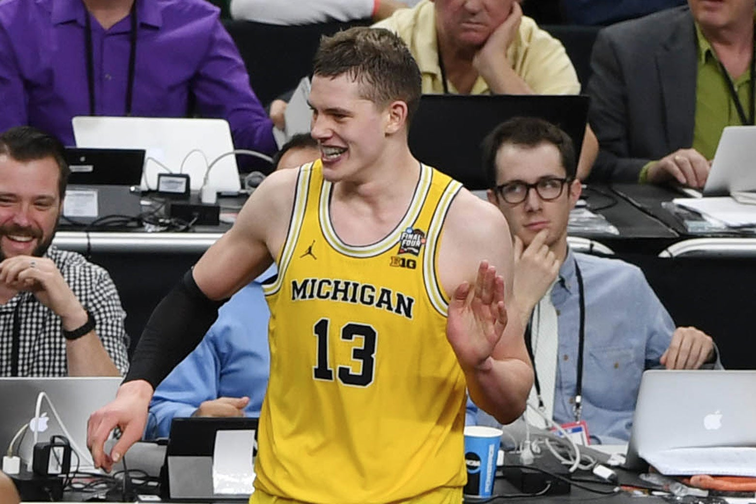 Mar 31, 2018; San Antonio, TX, USA; Michigan Wolverines forward Moritz Wagner (13) reacts with teammates Muhammad-Ali Abdur-Rahkman (12) and Charles Matthews (1) after falling into the press table in the second half in the semifinals of the 2018 men's Final Four at Alamodome.