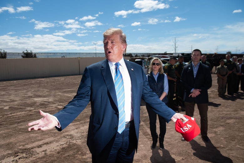 President Donald Trump tours the border wall between the United States and Mexico in Calexico, California, April 5, 2019.