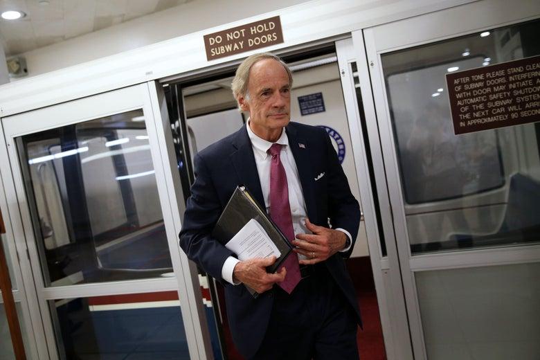 Sen. Tom Carper speaks to reporters in the U.S. Capitol.
