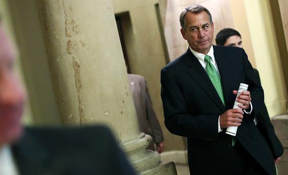 Speaker of the House John Boehner (R-OH) walks to the House chamber to speak on the pending 'fiscal cliff'.
