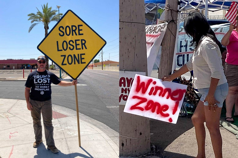 """A man with a """"SORE LOSER ZONE"""" sign and a woman with a """"WINNER ZONE"""" sign."""