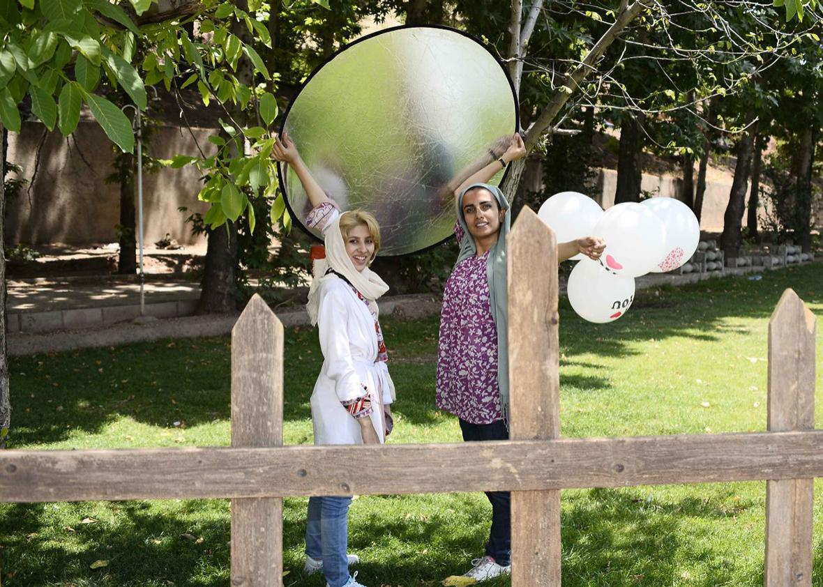 Somayeh Pakar (right) and her assistand at an outdoor wedding photoshoot.