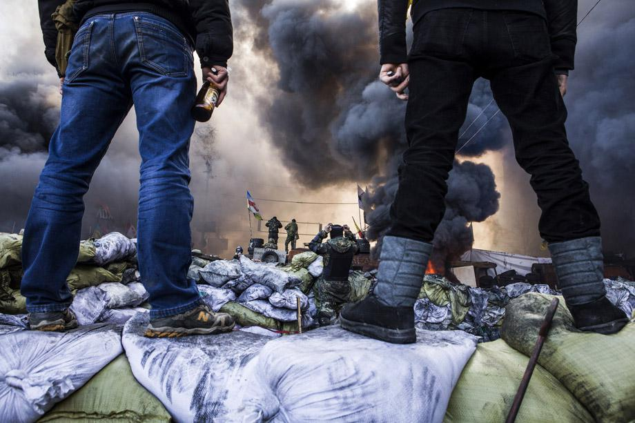 Demonstrators stand on barricades during clashes with riot police in Kiev on Feb. 18, 2014.