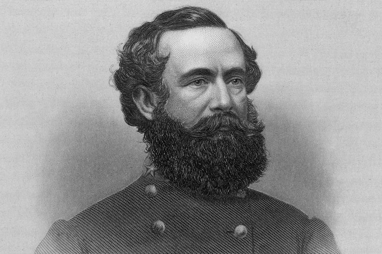 A black-and-white illustration of a dark-haired man with a large beard wearing what appears to be a military jacket.