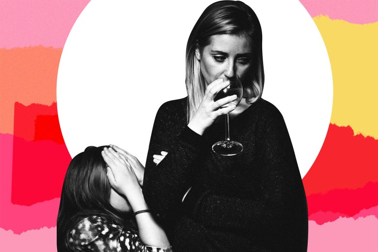 A mom drinking wine in front of her child.