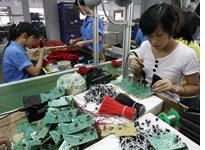 Workers assembling toys on a production line in Shantou, China. Click image to expand.