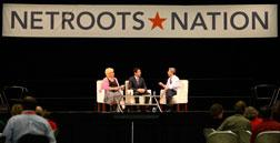 Rep. Joseph Sestak, D-Pa., right, talks with moderators Susie Madrak, left, and Ari Melber at Netroots Nation. Click image to expand.