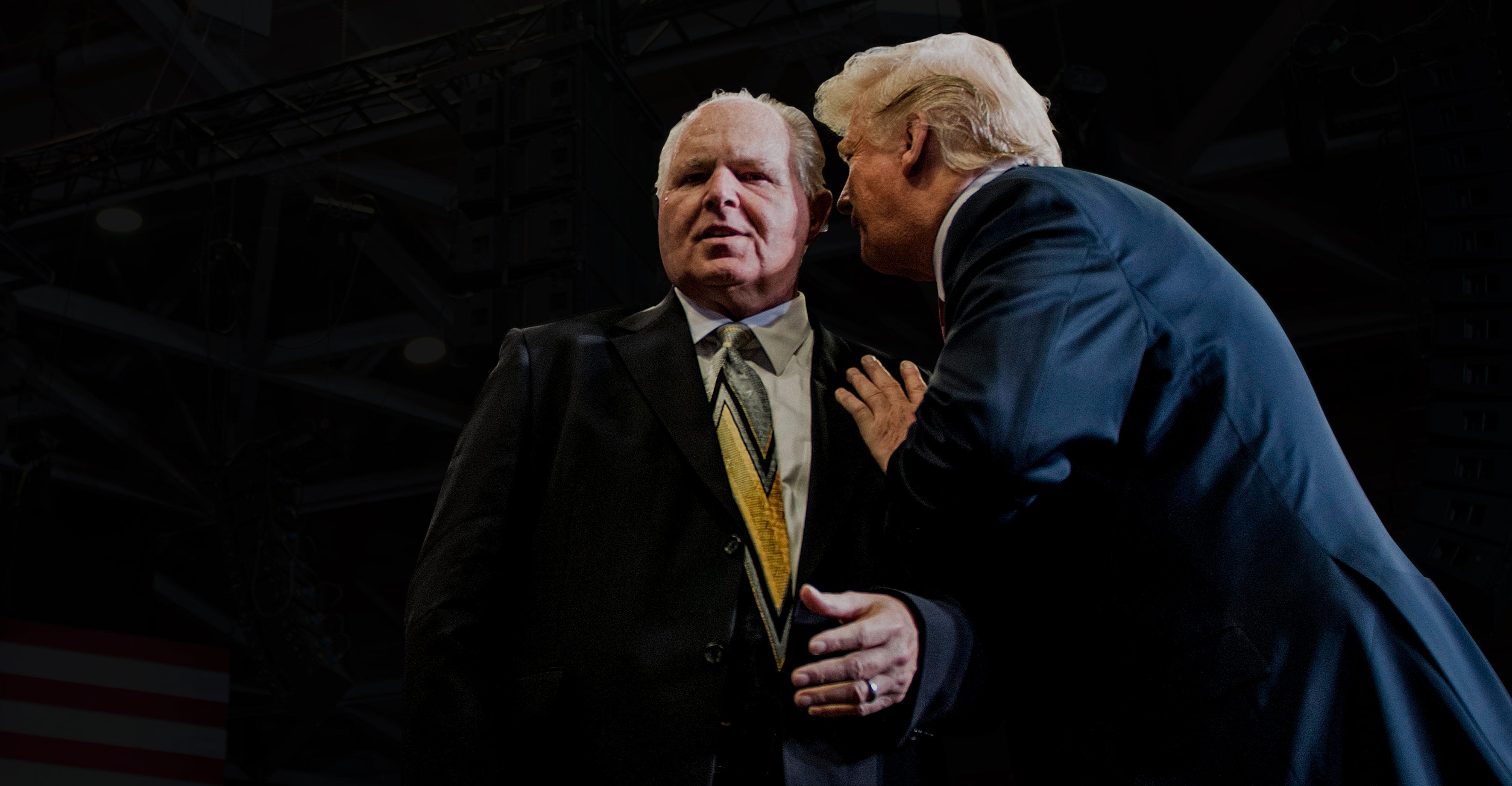 Donald Trump whispers in Rush Limbaugh's ear.
