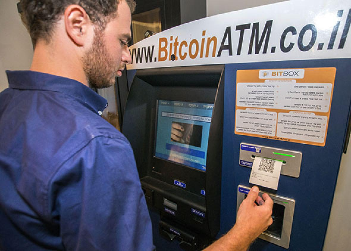 Above, an Israeli man buys bitcoins at a bitcoin ATM in Tel Aviv, on June 11, 2014.