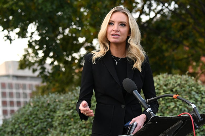 McEnany, maskless, speaking into a mic