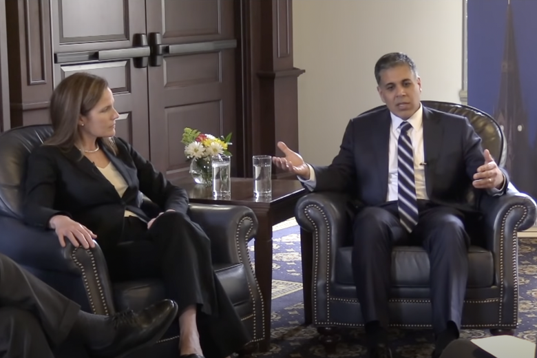 Amul Thapar and Amy Coney Barrett have a conversation while sitting down at a law school.
