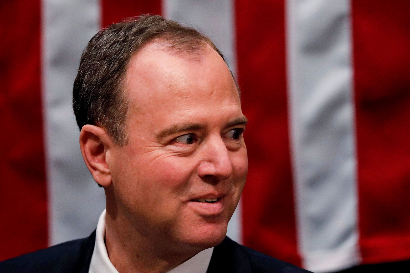Adam Schiff in front of an American flag.