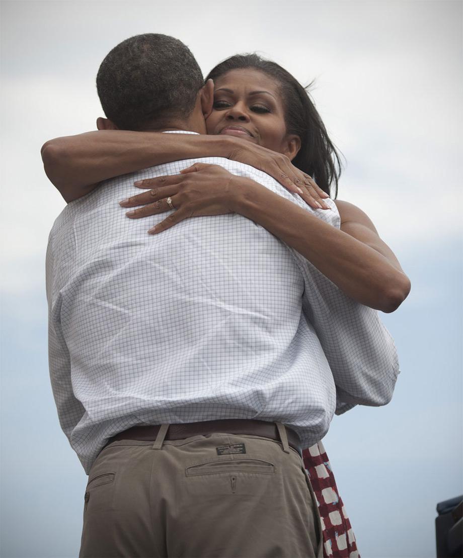 Michelle and Barack Obama hugging