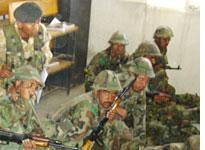 Recruits at Kabul's Afghan National Army Training Center learn how to load and aim rifles. Click image to expand.