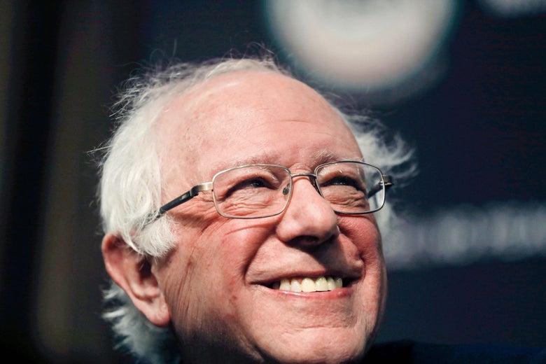 Bernie Sanders smiling.