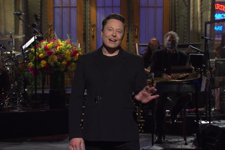 Elon Musk standing on the Saturday Night Live stage.
