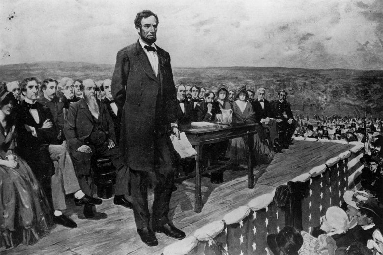 Painting of Abraham Lincoln delivering the Gettysburg Address. Holding a piece of paper, he stands on a raised platform with people seated behind him and standing below him.