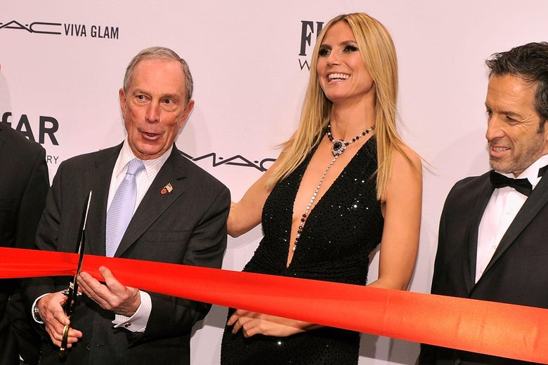Mike Bloomberg cuts a ribbon next to Heidi Klum.