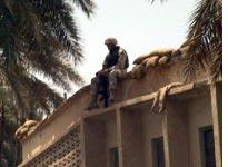 A soldier guarding a library in Baghdad