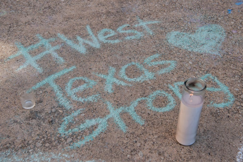 A chalk message at a memorial for victims of a mass shooting, at the University of Texas of the Permian Basin (UTPB) on September 2, 2019 in Odessa, Texas.