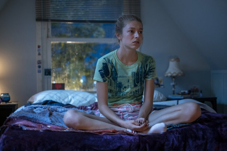 Euphoria's Jules sits on a a bed in her room, alone.