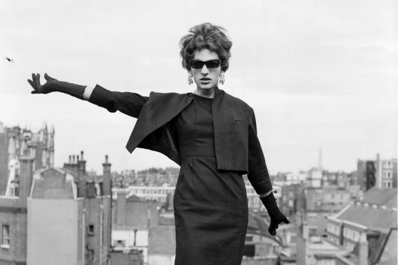 A drag queen posing on a rooftop in London, England.