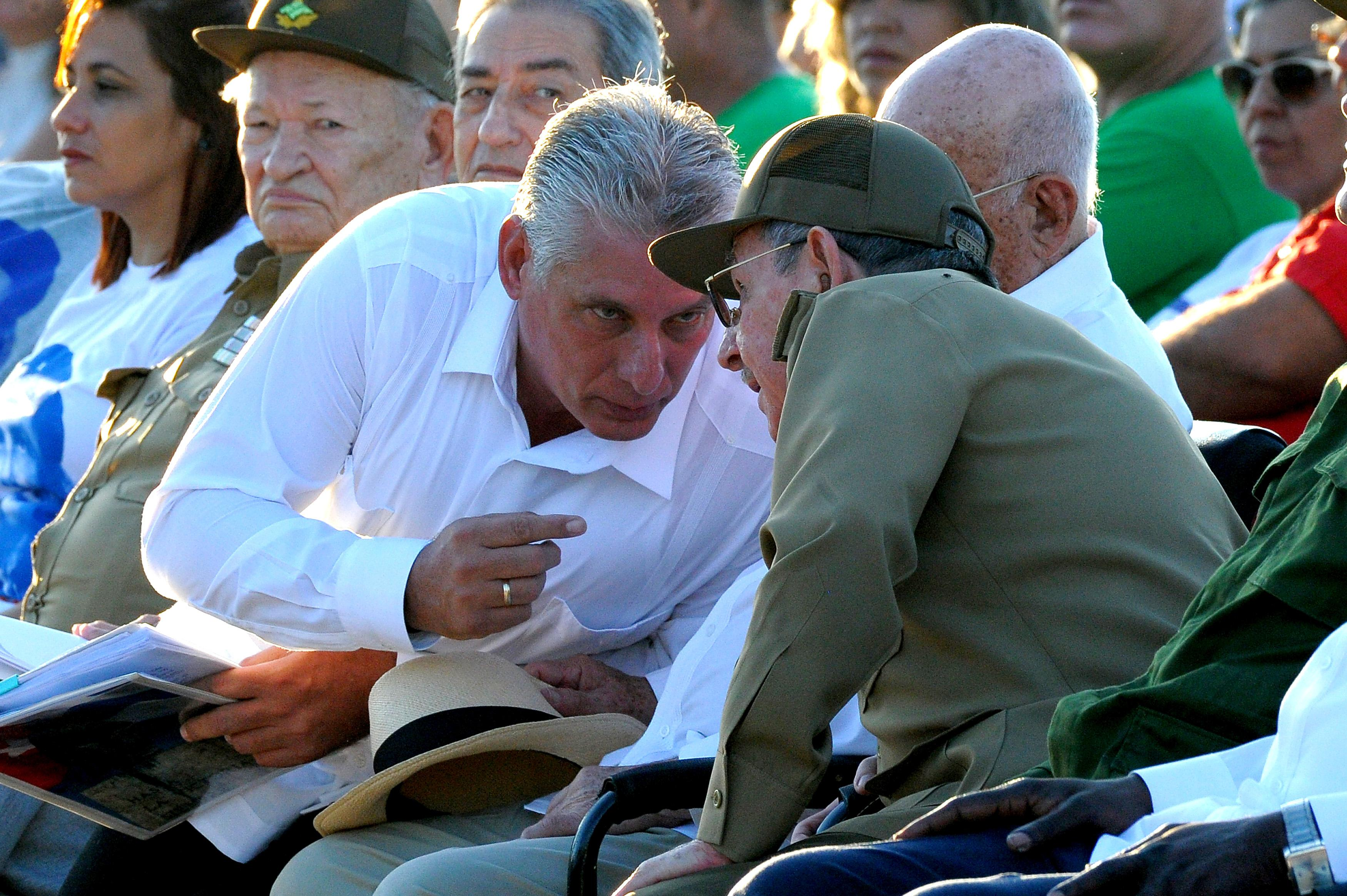 (FILE) Picture taken on on October 8, 2017 showing Cuban President Raul Castro (R) talking to First Vice President Miguel Diaz Canel (L), during the homage for the 50th anniversary of Ernesto 'Che' Guevara's death, in Santa Clara, Cuba.          Cuba is preparing for the end of an era next week when Raul Castro steps down as president, ending his family's six-decade grip on power, and paving the way for a younger leader. But analysts say his replacement, expected to be 57-year-old Miguel Diaz-Canel -- currently Cuba's first vice president -- won't quite be alone at the helm of the communist island. / AFP PHOTO / YAMIL LAGE / TO GO WITH AFP STORY by Alexandre GROSBOIS        (Photo credit should read YAMIL LAGE/AFP/Getty Images)