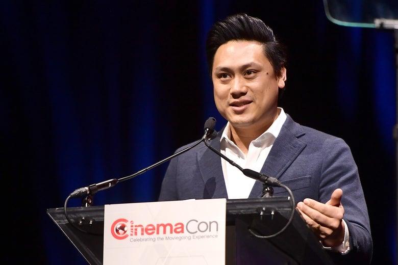 Jon M. Chu standing behind a podium.