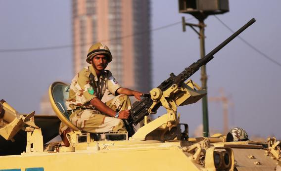 Members of the Egyptian military man an armored vehicle as they guard a bridge near Tahrir Square on July 8, 2013