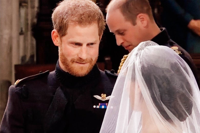 Prince Harry bites his lip while gazing upon the visage of his bride.