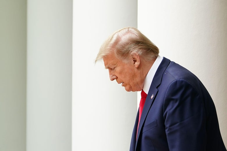 Trump walks with his head down.