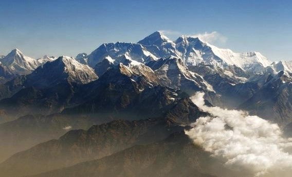 Mount Everest (C), the world highest peak, and other peaks of the Himalayan range.