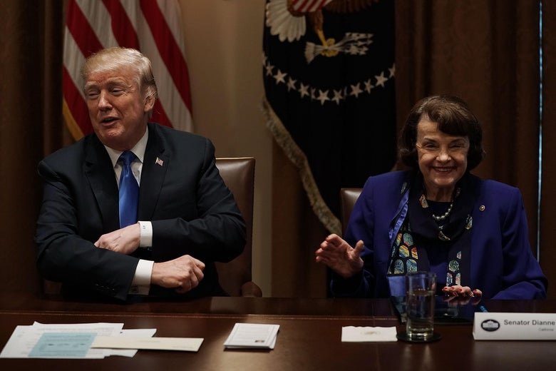 WASHINGTON, DC - FEBRUARY 28:  U.S. U.S. President Donald Trump (L) and Sen. Dianne Feinstein (D-CA) (R) share a moment during a meeting with bipartisan members of the Congress at the Cabinet Room of the White House February 28, 2018 in Washington, DC. President Trump held a meeting with lawmakers to discuss school and community safety.  (Photo by Alex Wong/Getty Images)