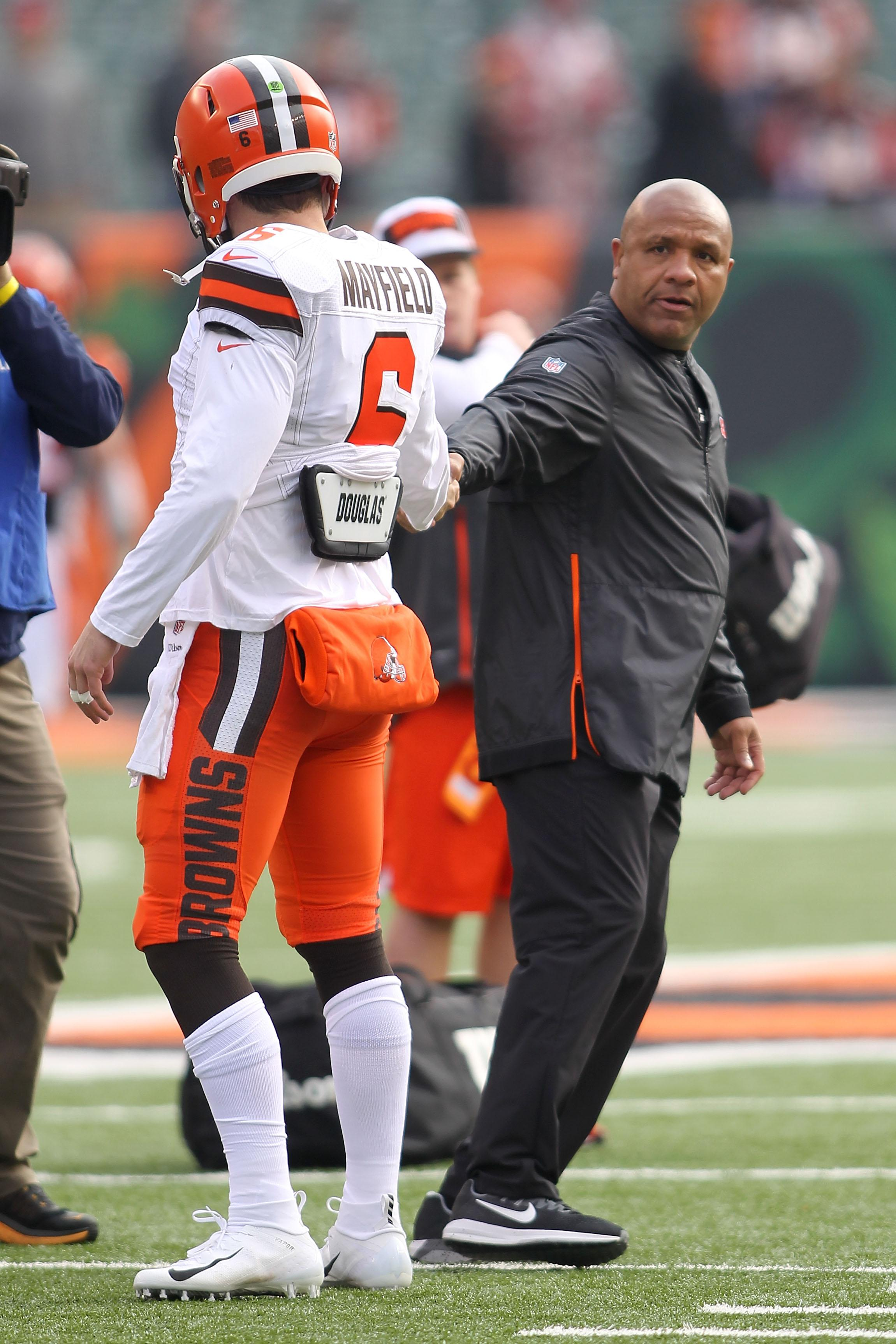 CINCINNATI, OH - NOVEMBER 25:  Special assistant to the head coach Hugh Jackson of the Cincinnati Bengals shakes hands with Baker Mayfield #6 of the Cleveland Browns at Paul Brown Stadium on November 25, 2018 in Cincinnati, Ohio. (Photo by John Grieshop/Getty Images)