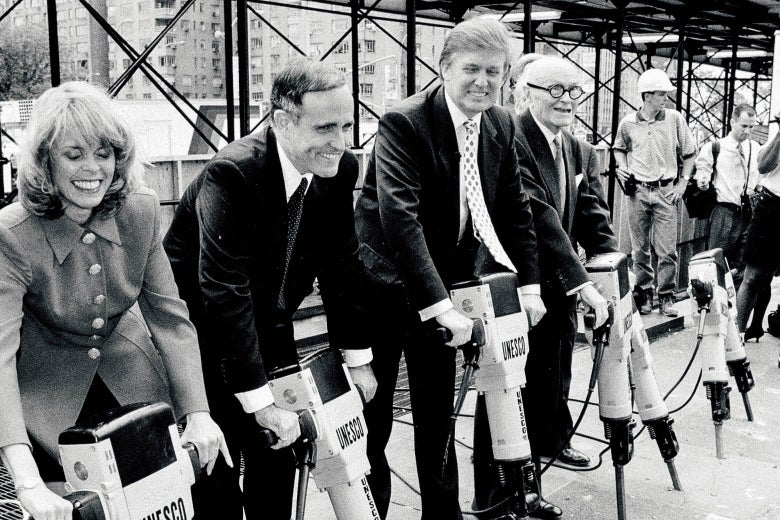 Giuliani, Trump, and others pose, holding jackhammers