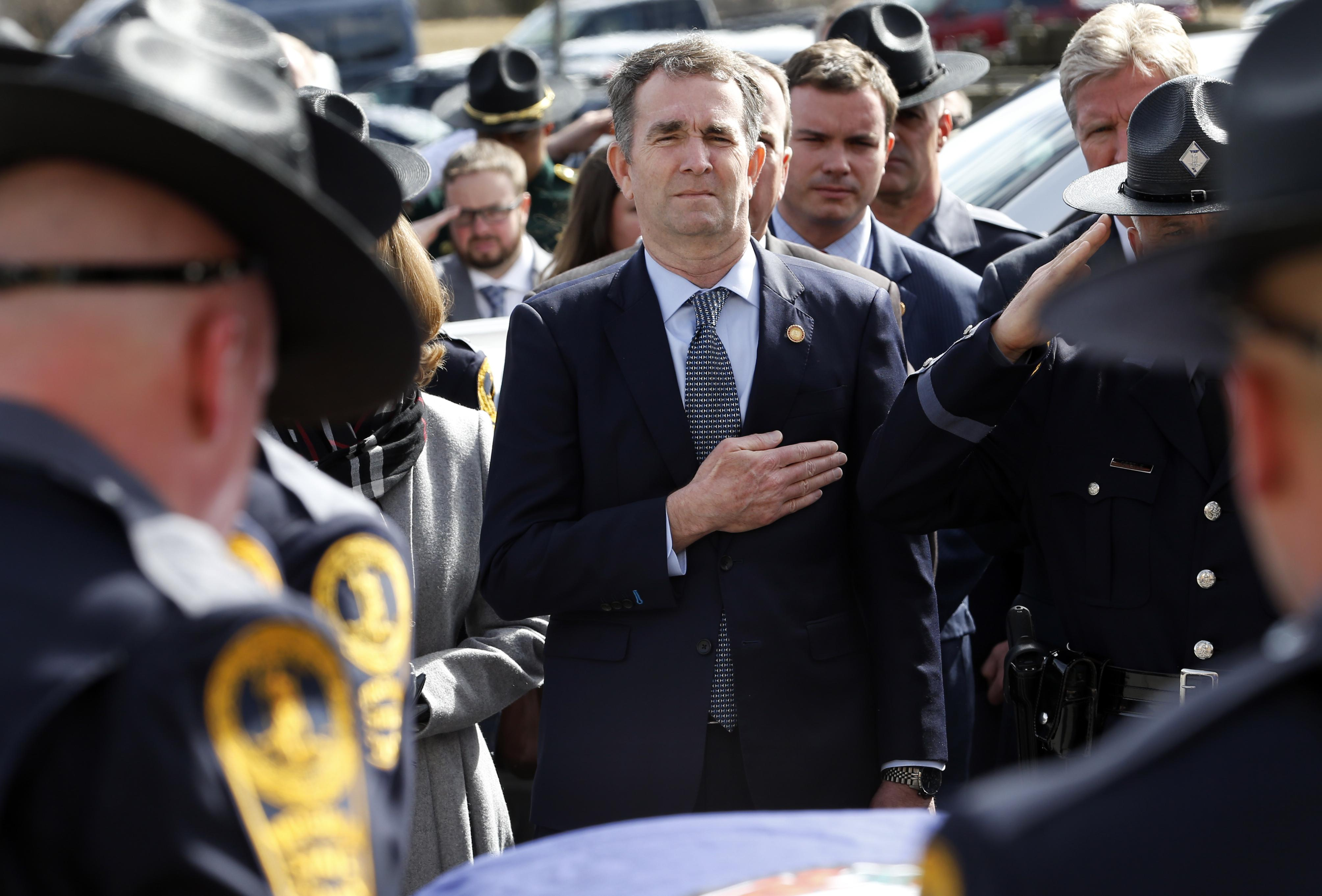 Virginia Gov. Ralph Northam watches as the casket of fallen Virginia State Trooper Lucas B. Dowell is carried to a waiting tactical vehicle during the funeral at the Chilhowie Christian Church on February 9, 2019 in Chilhowie, Virginia.